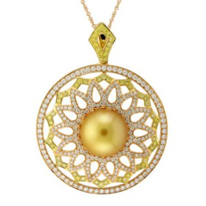 White and yellow diamonds set in 18kt gold with a pearl center from Yael Designs