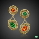 Tsavorite garnet, Spessarite garnet, and diamond earrings by AG Gems.
