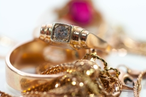 Gold Jewelry  With Gems , Chains Close Up Macro Shot Isolated On